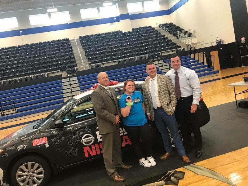 Dianna Hodza at Centennial High School on Tuesday May 23rd  winner of Burleson Nissan's Strive to Drive Give away, Burleson Nissan GM Justin Crain and her new Nissan Sentra