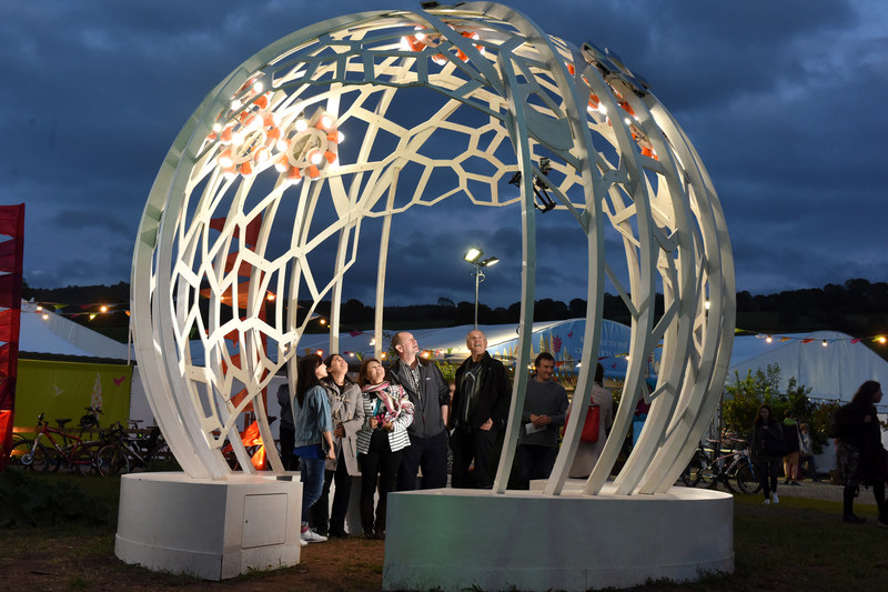Hay Festival goers admire the 'Night Time Sun', an interactive art installation inspired by Jaguar Land Rover's 'Lighting up Lives' solar project in Kenya (PRNewsfoto/Jaguar Land Rover)