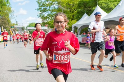 Runners of all ages participated in the 43rd Tamarack Ottawa Race Weekend. Young runner Camille competed in the 2K race. (Photo credit: Brittany Gawley) (CNW Group/Scotiabank)