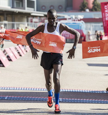Winner of the Scotiabank Calgary Marathon, Daniel Kipkoech crosses the finish line with a time of 2:22:33. (Photo credit Dave Holland) (CNW Group/Scotiabank)