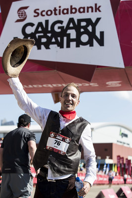 Justin Kurek earned himself a Guinness World Record on Sunday morning at the Scotiabank Calgary Marathon all the while, placing 7th overall dressed in jeans, a cowboy hat and chaps. (CNW Group/Scotiabank)
