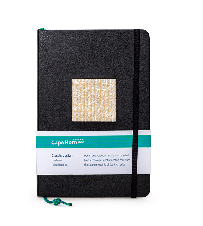 Designed in the southernmost tip of South America, Cape Horn handmade notebooks help you keep a log of your best and wildest ideas. The unique fragments on their covers come from sails that have traveled thousands of miles on the open sea, and were made of the most innovative fibers. It is a hard cover, ruled notebook, 240 Pages. 5.5 x 0.7 x 8.3 inches. Each thread-bound book opens flat and contains a gusseted pocket for sheets, page marker made of sailing rope, and elastic enclosure band.