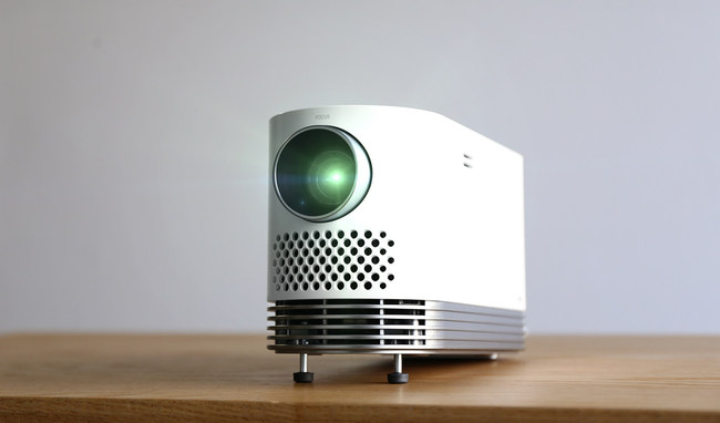 The LG ProBeam projector (model HF80JA) is equipped with an advanced laser engine that produces up to 2,000 lumens of brightness and features a slim, sleek design, which makes it more portable, thanks to its innovative I-shaped laser engine. Employing a compact standing-type design, the 4.6-pound LG ProBeam is one of the industry's lightest Full HD laser projectors in the brightness range of 2,000 lumens.
