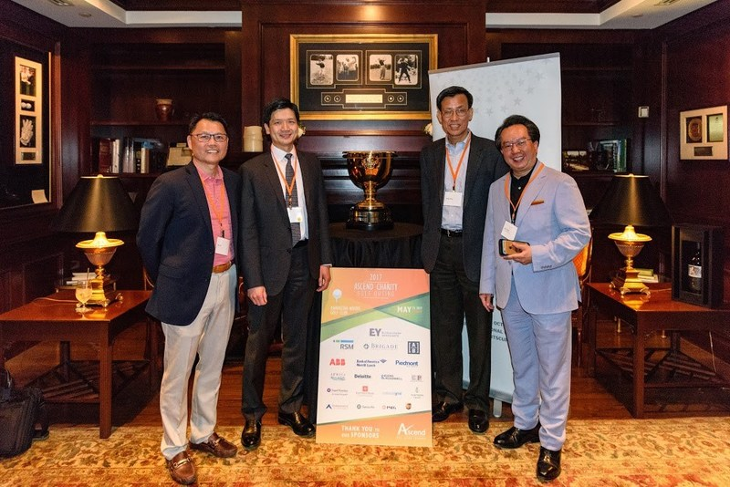 """From L-R: Hee Lee, Co-Founder of Ascend, Chair of the Ascend Golf Outing Steering Committee, and Partner, EY; Andrew Y. Chin, Chief Risk Officer and Head of Quantitative Research, AB; Qingji Yang, Ph.D., Principal, EY; and Savio Chan, Chairman of the Ascend Golf Outing and Best-Selling Author of """"China's Super Consumers"""" at the inaugural Ascend Charity Golf Outing with The Presidents Cup."""