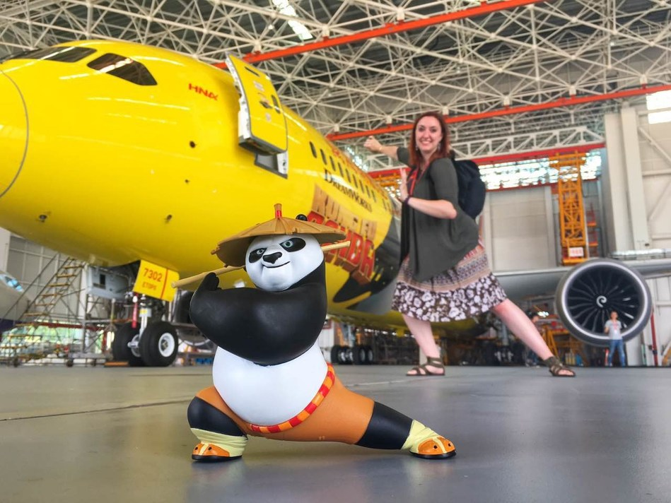 Hannah Foss, the winner of Hainan Airlines' Design Your Own Livery contest in North America, visits the airline's hangar