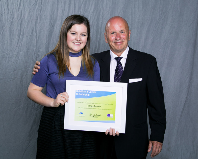 Retail as a Career Scholarship Winner Sarah Bennett with Interac's Gary Locke (CNW Group/Retail Council of Canada)
