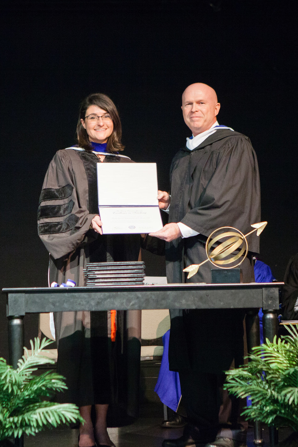 Phil Kilgore, Director of the Barney Charter School Initiative at Hillsdale College presents Dr. Kathleen O'Toole, headmaster of Founders Classical Academy with the 2017 Henry Salvatori Prize for Excellence in Teaching