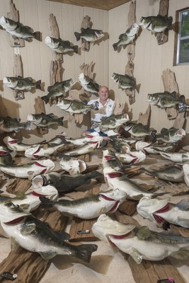 Scottie Lucas of Scottie's Taxidermy is surrounded with replicas of the 2016-17 crop of double-digit bass entered into the Toledo Bend Lake Association Lunker Bass Program, which has been a hallmark of the reservoir's success. The program has awarded 881 replicas and has been a driving force behind Toledo Bend being designated the nation's No. 1 bass fishery two years running.