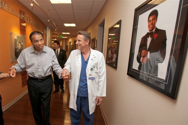 Results from a new study by Barrow Neurological Institute show that while 90 percent of Americans said they most remember Ali for his boxing career, more than 60 percent recall the dignity and grace with which he battled Parkinson's disease over the last three decades of his remarkable life. Here, Muhammad Ali walks the halls of the Muhammad Ali Parkinson Center with Robert Spetzler, MD, the director of Barrow Neurological Institute.