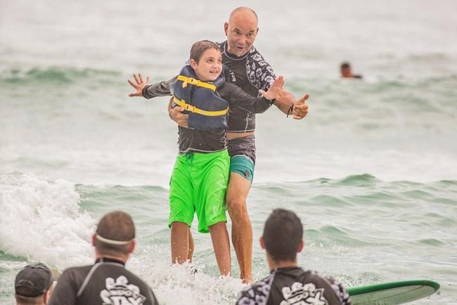 Jaylen Stanley with instructor Jack Viorel of Indo Jax Surf Charities - Courtesy of Jesse Stephenson