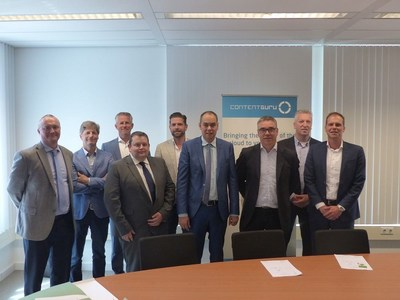 Contract signed by Sean Taylor (CEO, Content Guru) (fourth from right) and Jacob Groote (EVP Products, KPN) (third from right) (PRNewsfoto/KPN and Content Guru)