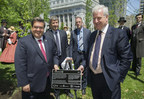 Montreal Mayor Denis Coderre, Tree Canada President Mike Rosen, CN Pensioners' Association President Yves Bourdon, and CN executive vice president Sean Finn unveil a plaque commemorating a special tree planting in downton Montreal in honor of Canada's 150th and Montreal 375th anniversaries. CN is donating up to $1 million to plant trees and improve Montreal's tree canopy in the coming years. (CNW Group/CN)