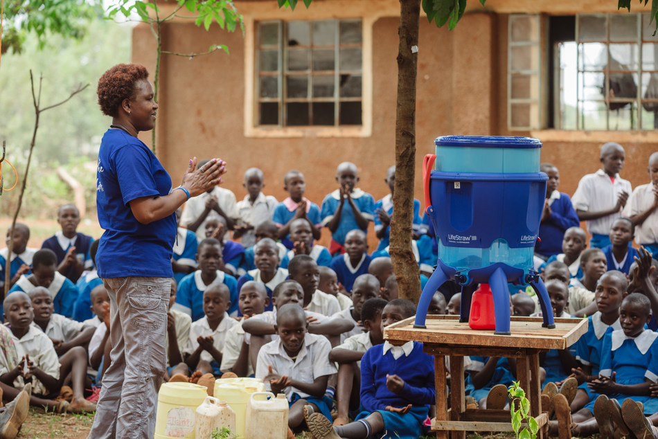 LifeStraw staff teaches students at elementary school in western Kenya about safe water and how to use the LifeStraw Community water purifier to transform contaminated water into safe drinking water.