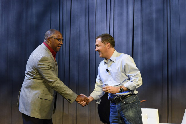 James Whitehurst, President and CEO of Red Hat, presents Dexter Henderson, Vice President of IBM's Power Systems, with the Red Hat Global Strategic Partner of the Year award at the 2017 Red Hat Summit in Boston.