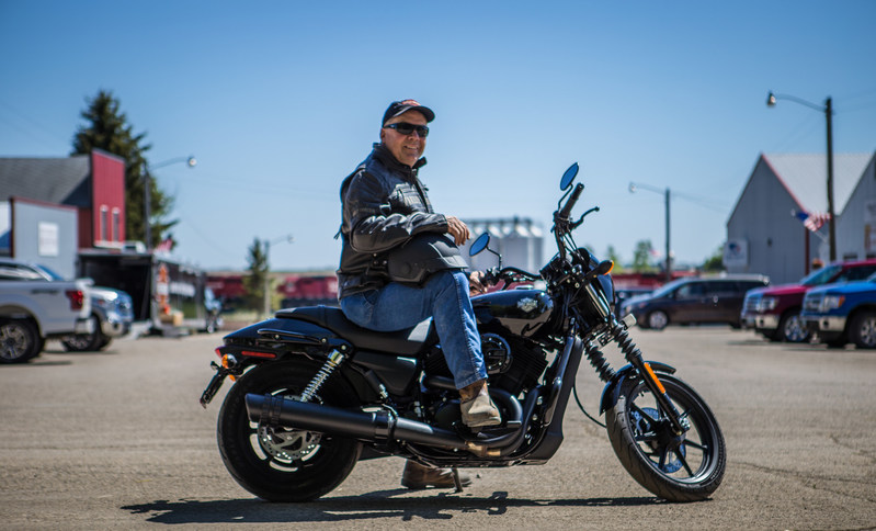 "Mayor of Ryder, Jody Reinisch, presides over the town's Main Street. To launch riding season, Harley-Davidson will ride into Ryder Saturday, June 3 with the aim of creating the first fully motorcycle licensed town. Ryder city officials will change the town's name to ""Riders"" this riding season to commemorate the experience."