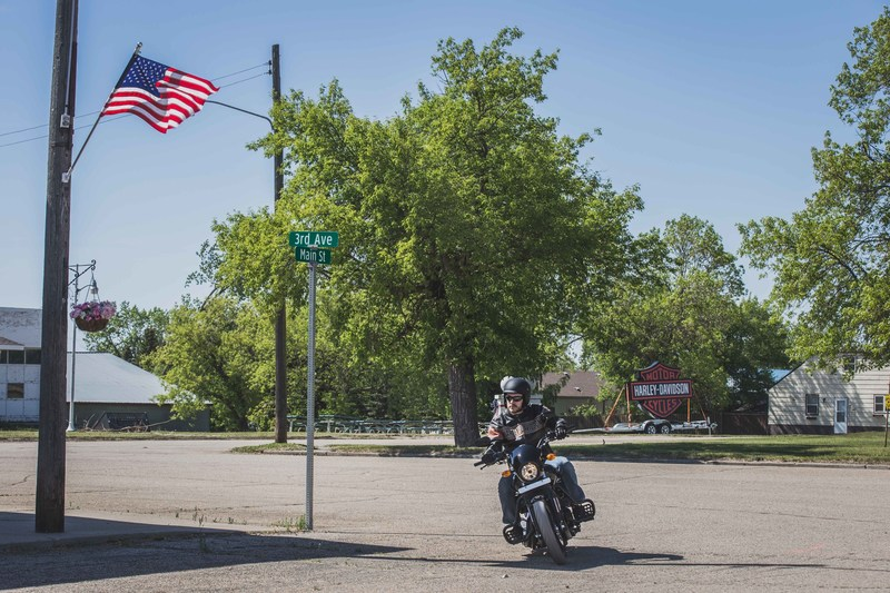 "Event staffer Joe Reed rides a Harley-Davidson Street 500 around Ryder, N.D., in anticipation of a Harley-Davidson Riding Academy demonstration Saturday, June 3. The motor company aims to create the first fully motorcycle licensed town. To commemorate the experience, Ryder city officials will change the town's name to ""Riders"" this riding season."