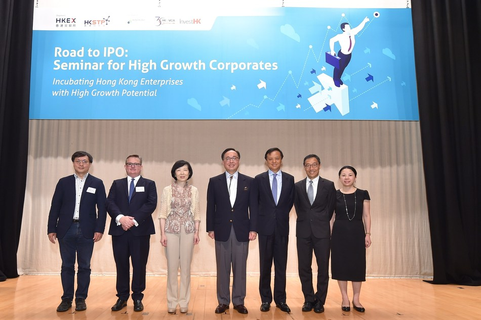 """Mrs Fanny Law, Chairperson of Hong Kong Science and Technology Parks Corporation (third from left), Mr Charles Li, Chief Executive of Hong Kong Exchanges and Clearing Limited (third from right) and Mr Albert Wong, Chief Executive Officer of Hong Kong Science and Technology Parks Corporation (second from right) shared their insights and knowledge on business and corporation development during the seminar of """"Road to IPO: Seminar for High Growth Corporate"""" held at Hong Kong Science Park. (PRNewsfoto/HKSTP)"""