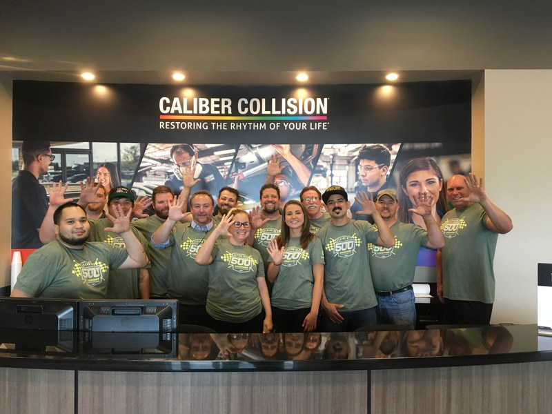 Caliber Collision teammates celebrate opening of company's 500th location in Ft. worth, Texas.