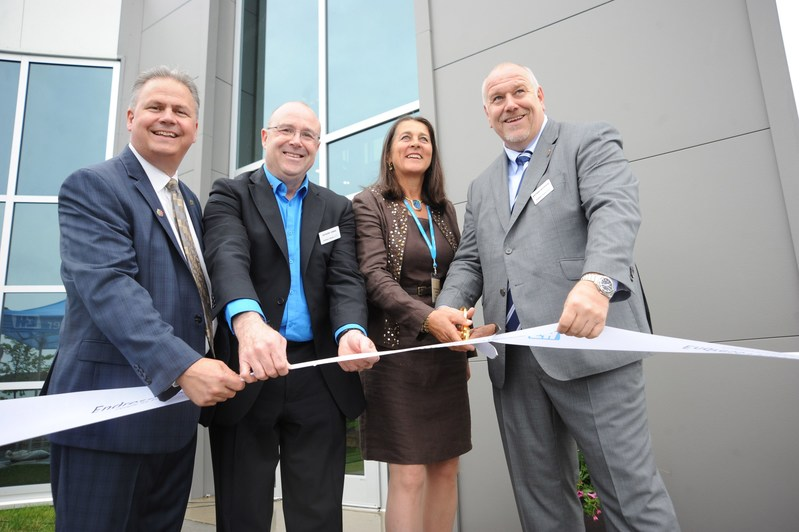 Ribbon cutting. From left to right: Todd Lucey, Sales Director, North America, Anthony Varga General Manager Canada, Jasmine Schellenberg, Endress family shareholder, and Matt Altendorf, Global CEO. (CNW Group/Endress+Hauser)