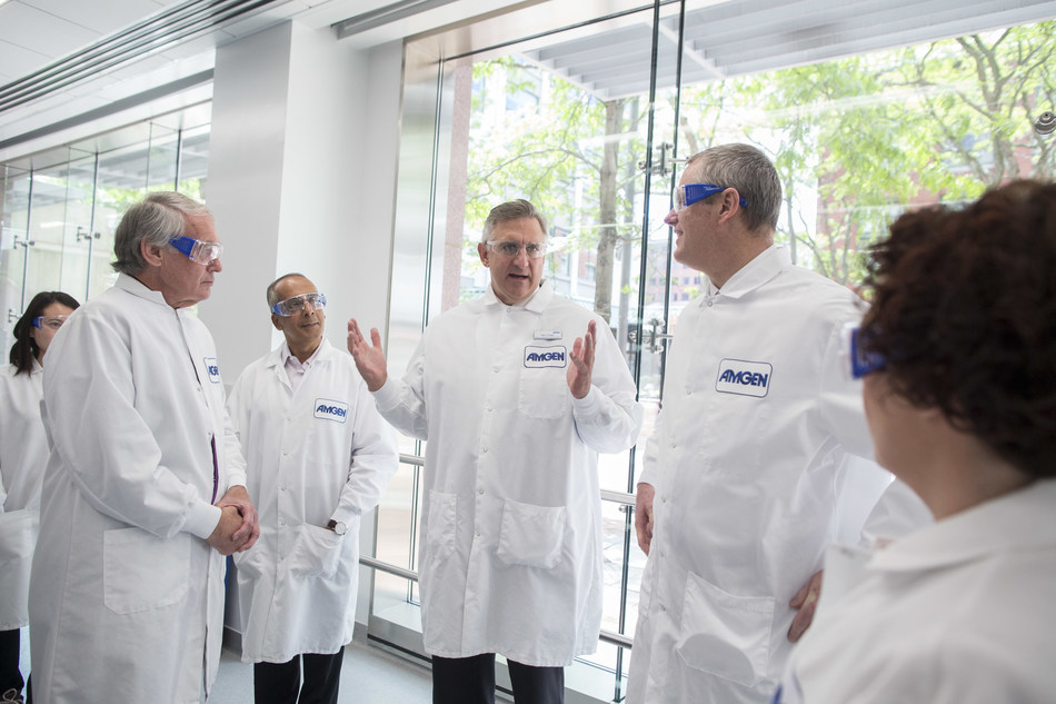 Robert A. Bradway, Chairman and Chief Executive Officer of Amgen, center, explains the company's commitment to Cambridge as one of its core research hubs to Senator Edward Markey, left, Shekar Ganesa, Executive Director of Process Development, Massachusetts Governor Charlie Baker and  Aine Hanly, Vice President, Process Development and Amgen Massachusetts Site Head, on Friday, June 2, 2017, in Cambridge, Mass. (Scott Eisen/AP Images for Amgen)