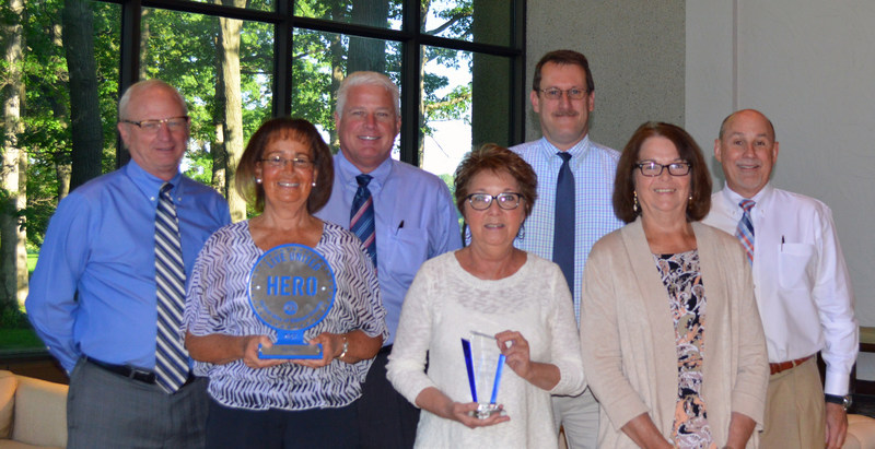 "Skyline Corporation's United Way Fundraising Team pictured with the prestigious Hero Award and ""Top Donor"" recognition."