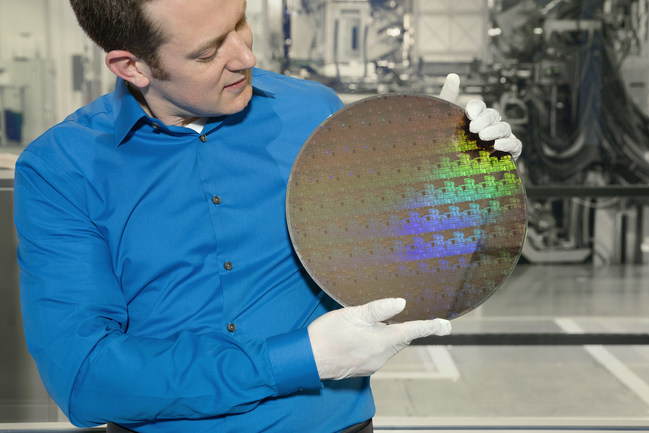 IBM Research scientist Nicolas Loubet holds a wafer of chips with 5nm silicon nanosheet transistors manufactured using an industry-first process that can deliver 40 percent performance enhancement at fixed power, or 75 percent power savings at matched performance.