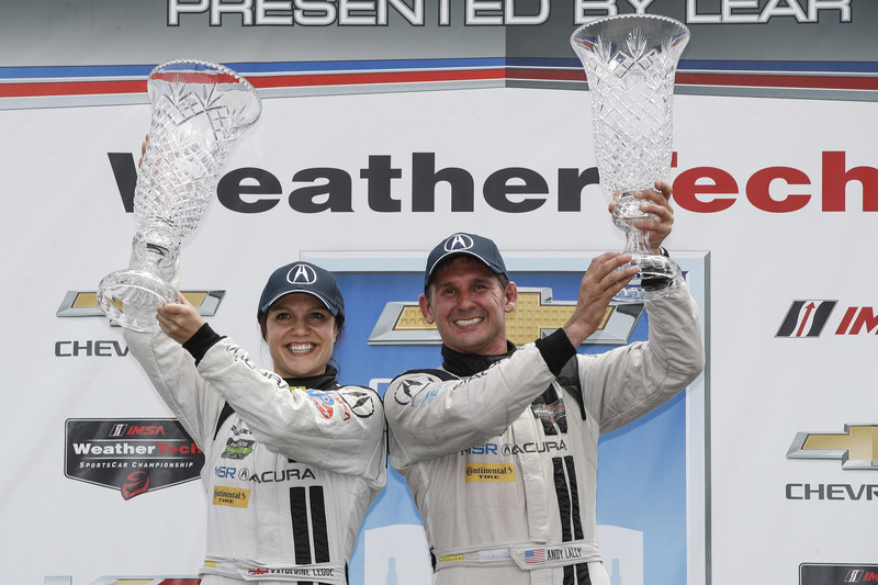 Michael Shank Racing drivers Katherine Legge, left, and Andy Lally celebrate the first victory of the Acura NSX GT3 in international sports car racing Saturday in Detroit, Michigan.
