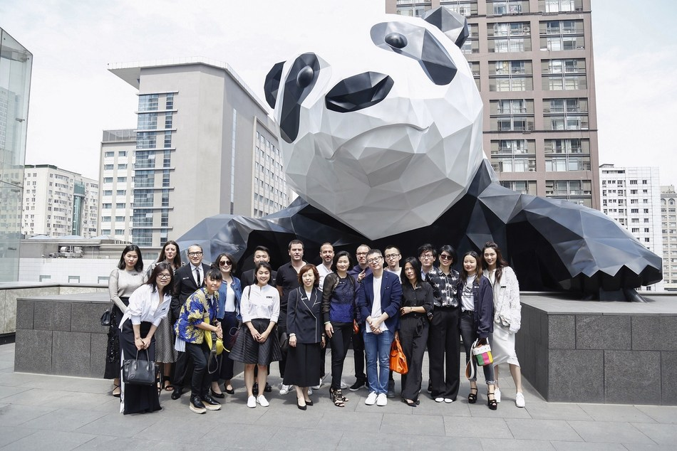"Guests of the first International Style Conference taking photo with ""I Am Here"", the one-of-a-kind panda theme public art installation located on the outside wall of Chengdu IFS"