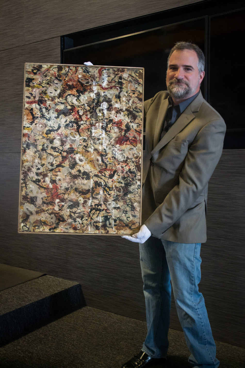 Auctioneer Josh Levine, owner and CEO of J. Levine Auction & Appraisal, holds a lost Jackson Pollock gouache painting that will be auctioned on June 20 in Scottsdale, Arizona. www.jlevines.com Photo credit: Sami Gill