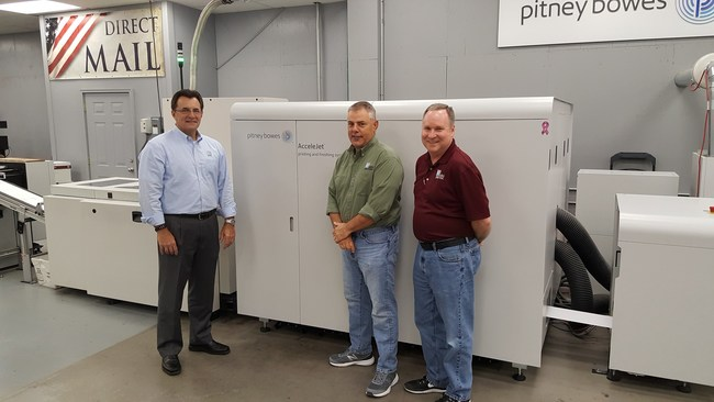 Mallery Mele, Kenny Burger and Mike Badeaux with the Pitney Bowes AcceleJet.