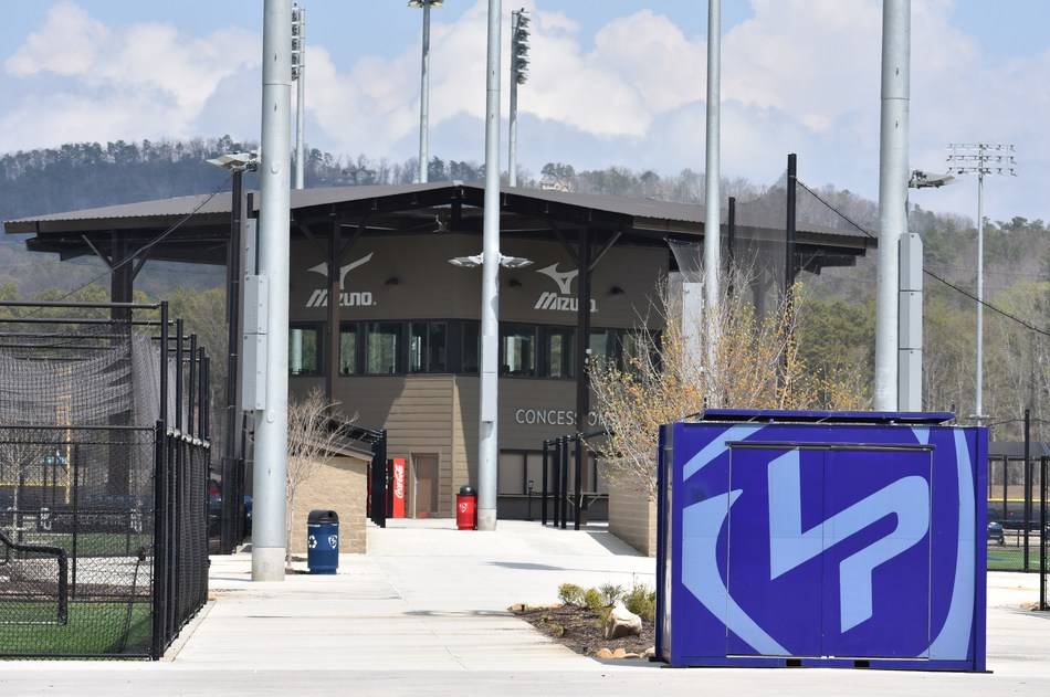"""As the Official Performance Sports Gear Partner of LakePoint Sporting Community, Mizuno will be the title host of tournaments, have retail kiosks at the baseball and softball fields offering premium Mizuno gear and apparel for purchase, and have a custom designed and branded scouting terrace, coined the """"Mizuno Mezzanine."""""""