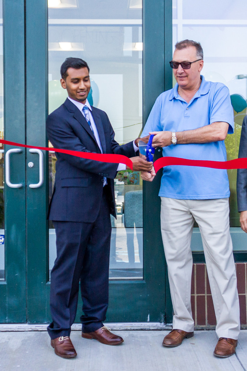 From left to right: Raj Shah, CEO of Agile Urgent Care, and Mayor Michael Gonnelli cut the ribbon at the company's grand opening ceremony on May 21.