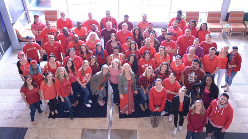 A group of Bridgepoint Education employees participate in Remember Everyone Deployed (RED) shirt Friday.