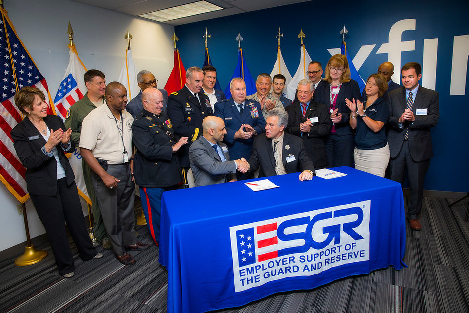 Jim Samaha, Senior Vice President of Comcast's Freedom Region, joined by New Jersey Employer Support of the Guard and Reserve Committee Chair Don Tretola, as well as Comcast and local military personal after signing the ESGR Statement of Support on Monday, June 5, in Voorhees, NJ.