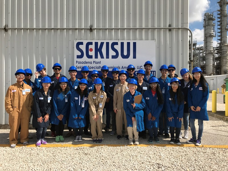 Dulles High School's organic chemistry students smile for a photo in their safety gear before a tour of the Sekisui Specialty Chemicals manufacturing plant in Pasadena, Texas.