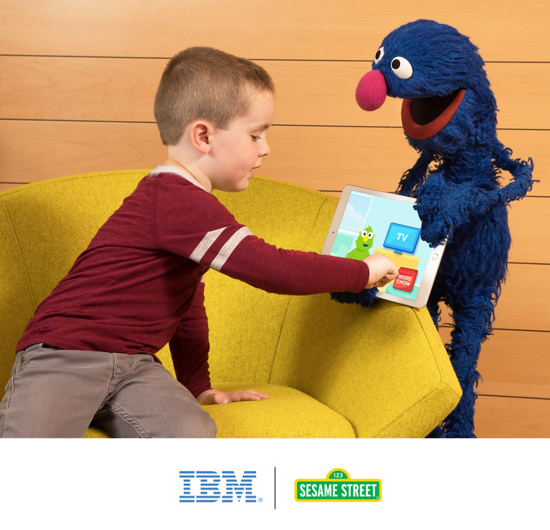 A child shows his friend Grover the new cognitive vocabulary learning app from IBM and Sesame Workshop. The app was recently piloted in Gwinnett County Public School System in Georgia to enhance students' vocabulary development. (Credit: John O'Boyle/Feature Photo Service for IBM)