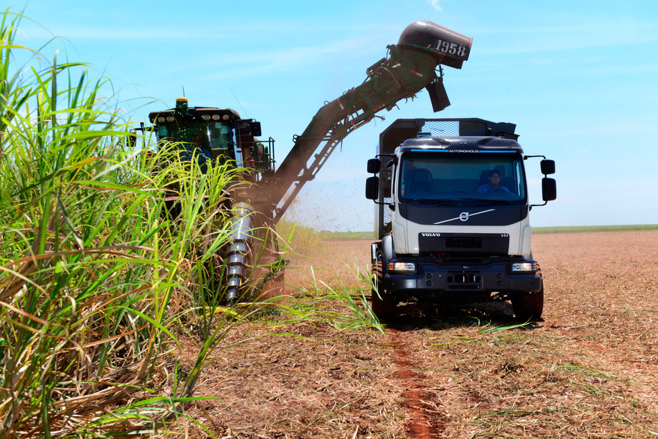 The automatic steering ensures that the truck is on the right course and distance to the harvester in order to avoid damage to the plants and compaction of the soil. (PRNewsfoto/Volvo Trucks)