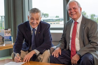 IEEE CS President Jean-Luc Gaudiot, and Gary Matkin, Dean of DCE/UCI, at MoU signing ceremony.