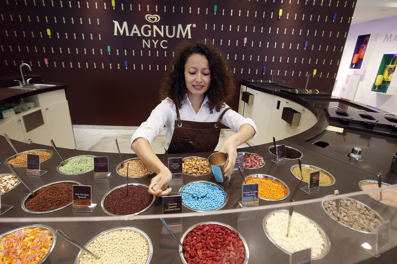 "A close-up of the MAGNUM New York ""dipping bar"" where guests can create custom MAGNUM bars hand-dipped in Belgian chocolate and adorned with three toppings from a selection of 20 premium ingredients including sorbet chocolate pearls, gold crystal candy, rose petals and dried raspberries. MAGNUM New York is located at 875 Washington Street in the city's Meatpacking District.  (Photo by Jason DeCrow for MAGNUM)"
