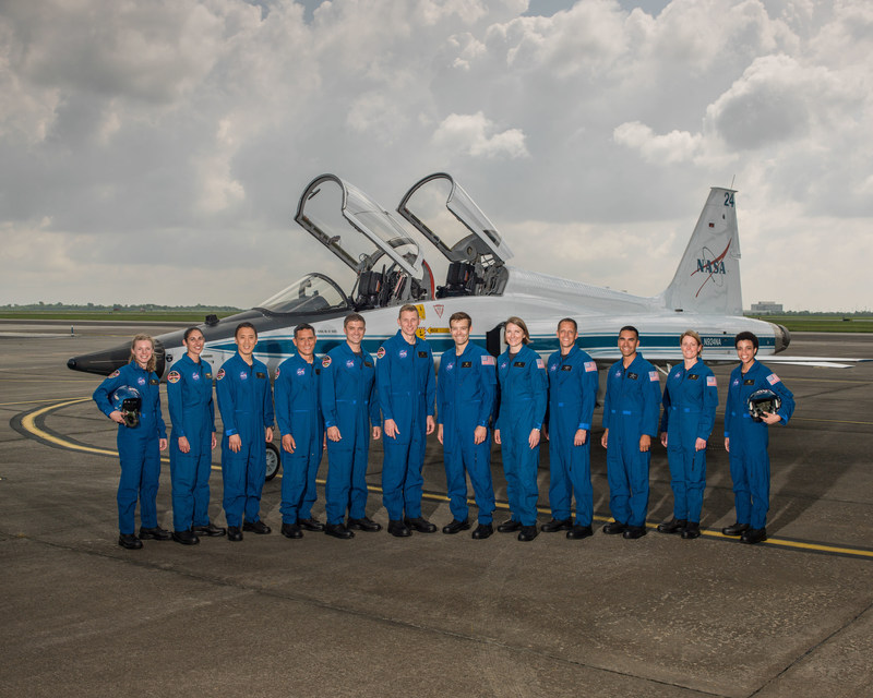 "NASA announced its 2017 Astronaut Candidate Class on June 7, 2017. The 12 candidates, pictured here at NASA's Ellington Field in Houston, are Zena Cardman, U.S. Marine Corps Maj. Jasmin Moghbeli, U.S. Navy Lt. Jonny Kim, U.S. Army Maj. Francisco ""Frank"" Rubio, U.S. Navy Lt. Cmdr. Matthew Dominick, Warren ""Woody"" Hoburg, Robb Kulin, U.S. Navy Lt. Kayla Barron, Bob Hines, U.S. Air Force Lt. Col. Raja Chari, Loral O'Hara and Jessica Watkins. Credit: NASA/Robert Markowitz"