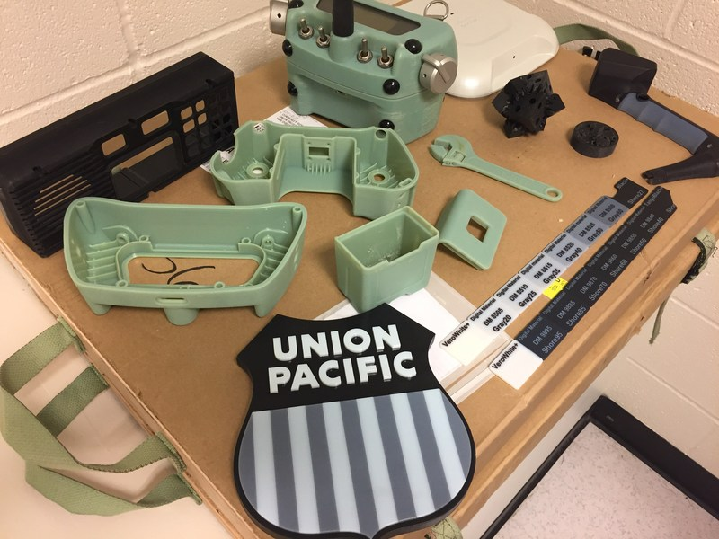 All items pictured were 3-D printed by Union Pacific, including the black panel in the upper left-hand corner, which is now used to house the in-cab locomotive radio system.