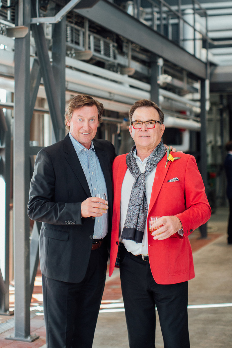 Wayne Gretzky and John Peller, CEO of Andrew Peller Ltd., in the brand new distillery to celebrate the Grand Opening of the Wayne Gretzky Estates Winery &Distillery in Niagara-on-the-lake. (CNW Group/Wayne Gretzky Estates Winery & Distillery)