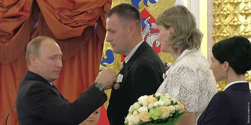 """Valeriy Novik, a father of eight, receiving the Order of """"Parental Glory"""" medal from President Putin."""