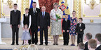 "Russian President Vladimir Putin awarded the Order of ""Parental Glory"" to Valeriy and Tatiana Novik, Jehovah's Witnesses from Karelia, during a ceremony in Moscow at the Kremlin. Six of their eight children are shown in the photo."