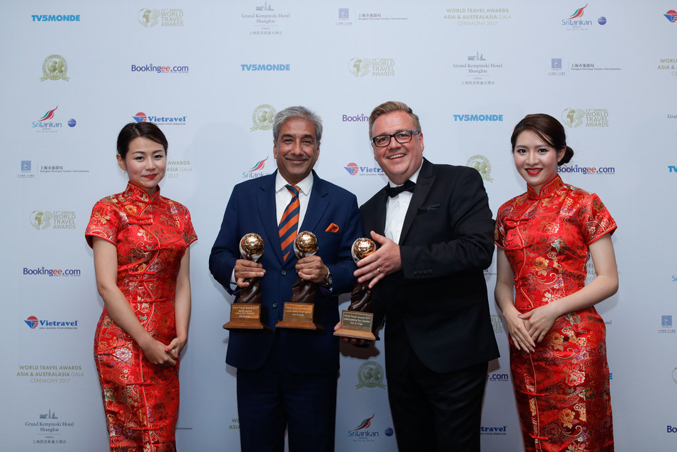 Sandeep Dayal, Head of Sales and Business Development, Cox & Kings (left) displaying the trophies along with Chris Frost, Vice President, World Travel Awards (right) at the World Travel Award ceremony in China. (PRNewsfoto/Cox & Kings Ltd.)