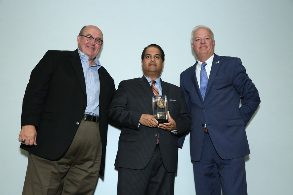 2017 S.M. Wu Research Implementation Award winner Ajay Malshe, PhD is congratulated by Dean Bartles, PhD, FSME, (L) and SME CEO Jeff Krause (R).