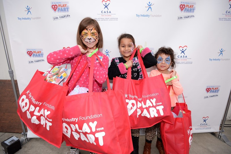 Local foster children enjoy an afternoon of toys and games during the Toy Industry Foundation's Play Your Part event in Los Angeles.