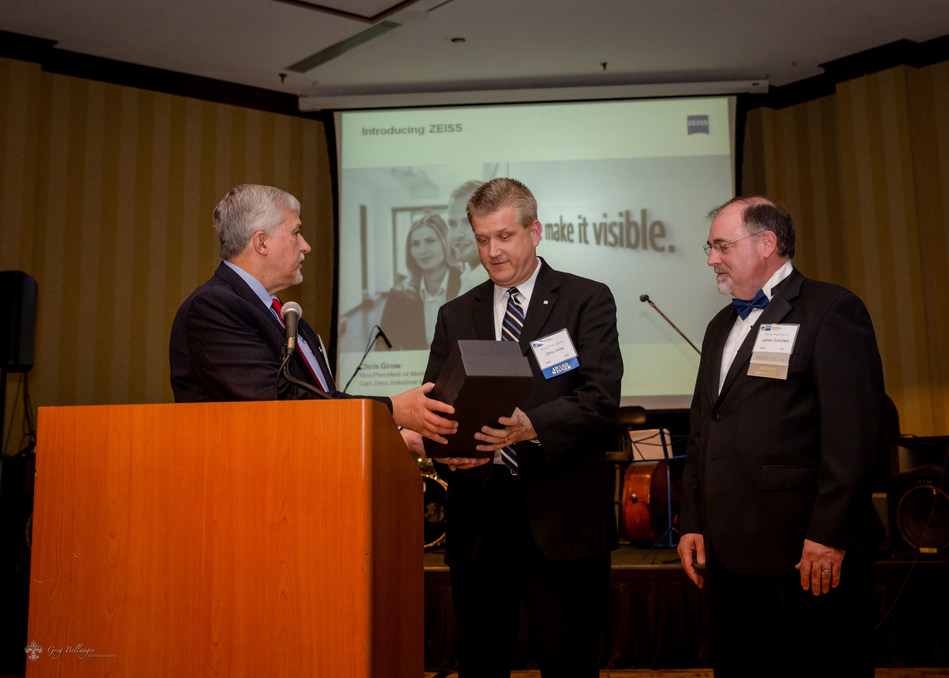 Chris Grow, from ZEISS Industrial Metrology, is presented with the Company of the Year Award at the GACC annual gala. Left to right: Don Keysser, GACC COTY Chair; Chris Grow, VP for Marketing and Customer Experience, ZEISS; James Schollett, GACC President. (PRNewsfoto/ZEISS Industrial Metrology)