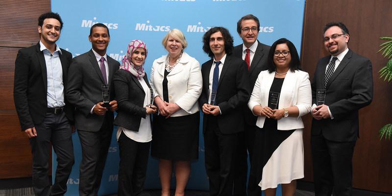 Photo from left to right: Ilyass Tabiai, Rolland Dellorme, Ashwaq Al-Hashedi, the Honourable Deb Matthews, Arash Samimi, Alejandro Adem, Asha Srinivasan, and Yaser Roshan. (CNW Group/Mitacs Inc.)