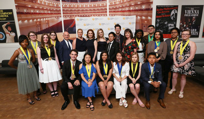 Pictured from center left to right, CEO and President of Scholastic, Richard Robinson, actress and comedian Amy Schumer, actor Ellie Kemper, actor Allison Williams (Girls & Get Out), artist Paul Chan, Awesomeness TV host Hunter March and Executive Director of Alliance for Young Artists & Writers, Virginia McEnerney, pose with the 2017 Gold Medal Portfolio recipients at the National Ceremony for the 2017 Scholastic Art & Writing Awards held at Carnegie Hall, New York, N.Y., Thursday, June 8, 2017